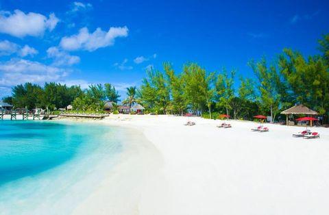 Sky, Daytime, Natural landscape, Beach, Caribbean, Tropics, Vacation, Shore, Sea, Coastal and oceanic landforms,