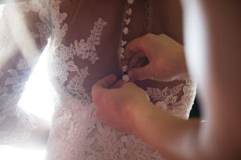 Finger, Hand, Nail, Wrist, Embellishment, Wedding dress, Lace, Bridal clothing, Artisan, Wedding ceremony supply,