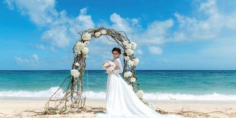 Photograph, Bride, Arch, Sky, Wedding dress, Dress, Wedding, Honeymoon, Gown, Ceremony,