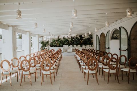 Function hall, Room, Chair, Building, Table, Furniture, Aisle, Restaurant, Interior design, Architecture,