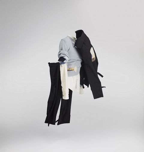 White, Standing, Outerwear, Costume, Robe, Formal wear, Fictional character, Sleeve,