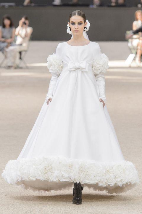 Fashion model, Clothing, Dress, Gown, Wedding dress, Shoulder, White, Fashion, Haute couture, Bridal clothing,
