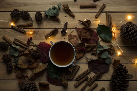 Lighting, Branch, Still life photography, Interior design, Table, Candle, Floral design, Still life, Tableware,