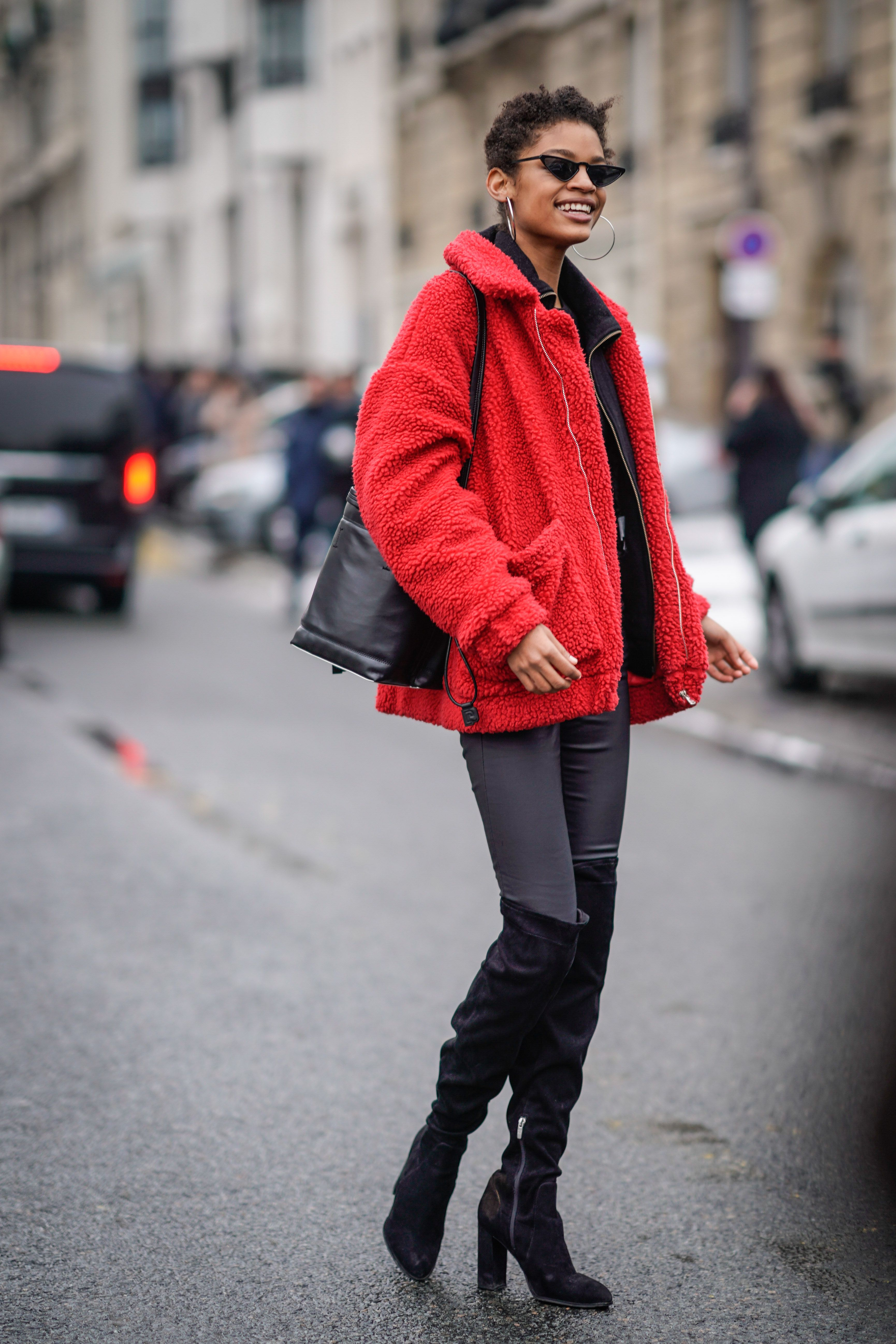 PARIS, FRANCE - MARCH 01:  A model wears a red coat, black thigh high boots, during Paris Fashion Week Womenswear Fall/Winter 2018/2019, on March 1, 2018 in Paris, France.  (Photo by Edward Berthelot/Getty Images)