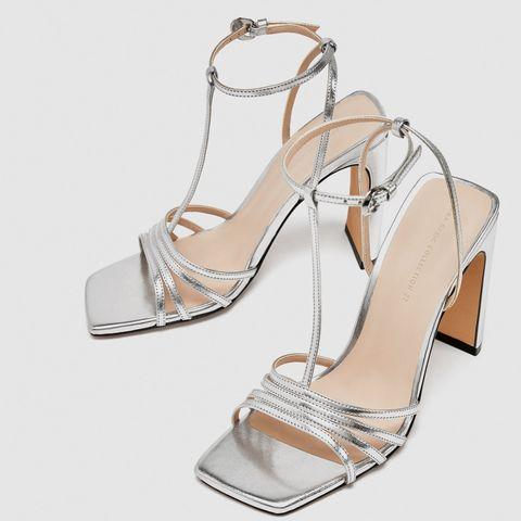 Footwear, Sandal, Shoe, High heels, Bridal shoe, Leg, Slingback, Beige, Silver, Fashion accessory,
