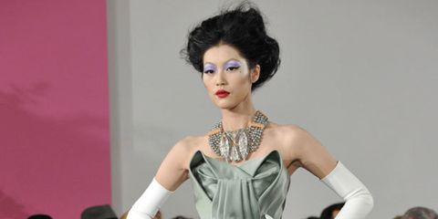 <p>Both Kylie and Dita von Teese sat front row this afternoon to see what John Galliano had to offer, and they watched an extravagant parade of equestrian themed outfits parade down the runway. And, of course, the man himself embraced the theme for his fi