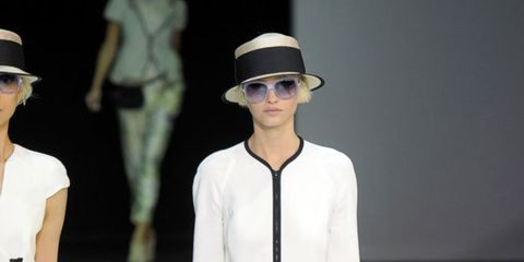 <p>The first half of the collection stuck firmly to black and white, to such and extent that pairs of models took to the runway wearing the same looks but in reverse - a pair of black silk trousers with white trim was mirrored by a black pair with white t