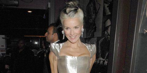 <p>Daphne Guinness in a silver Alexander McQueen dress now up for auction</p>