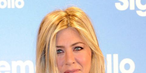 <p>Jennifer Aniston stepped out today in Madrid, at the premiere of her new film Just Go With It, sporting a long bob and a lighter blonde hair colour. But, she has kept with her tried and tested shape - centre parting and no layers - but gone short with
