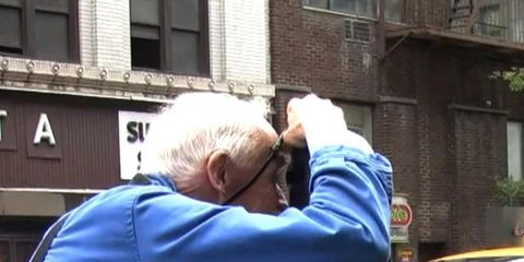 <p>Photographer Bill Cunningham at work on the New York City streets.</p>