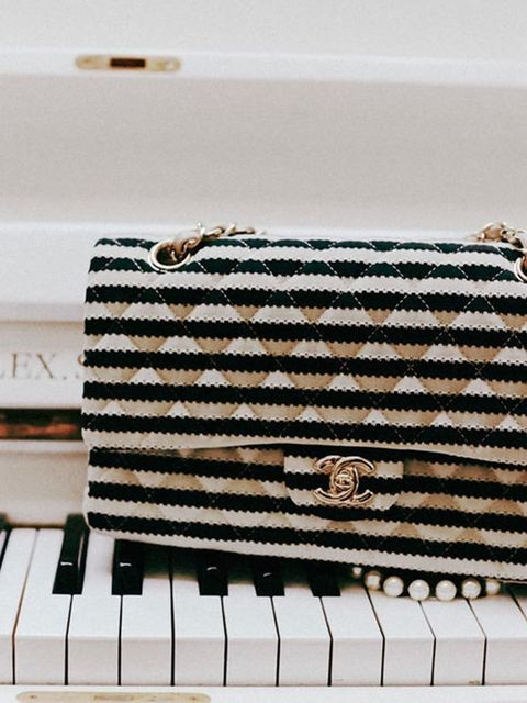 <p>Caroline's striped Gucci handbag.</p>