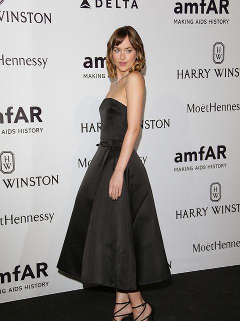 Dakota Johnson attends the amfAR Milano gala, Milan, September 2015.