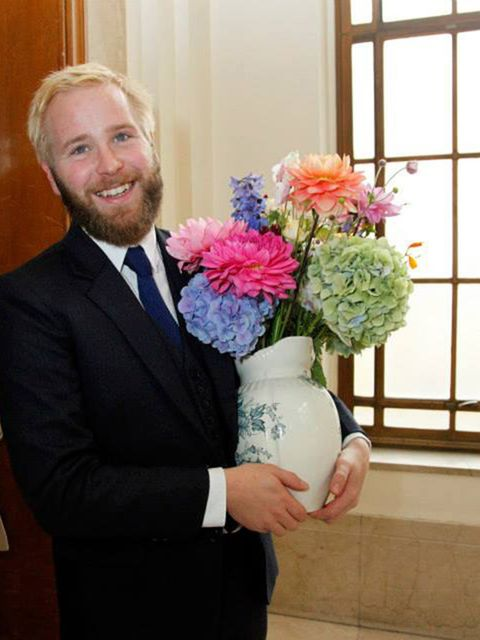 <p>The flowers were a beautiful bouquet in an extra large colourful jug (plus hair flowers) from The Flower Appreciation Society.</p>  <p>My parents and I made additional table decorations with blue and yellow flowers from New Covent Garden Flower Market.