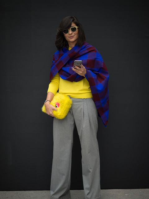 Ferhan Talib wears a shawl from Tanzania, a yellow Cos top, River Island trousers and a Zara bag.