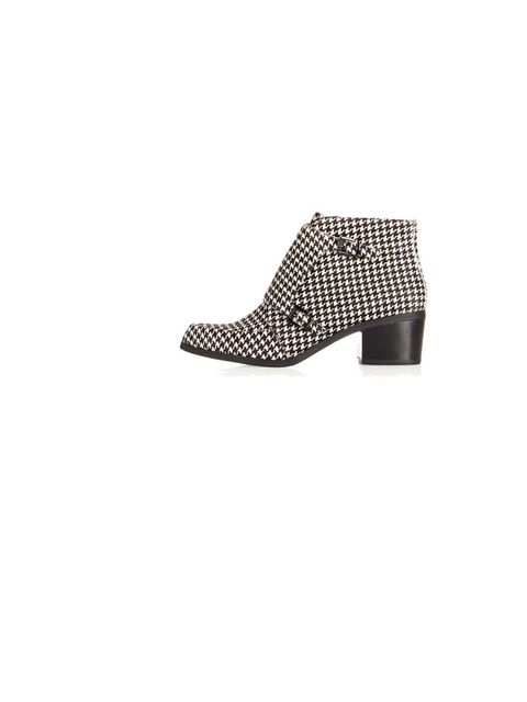 """<p>A graphic alternative to solid black but still keeps things neutral. </p><p><a href=""""http://www.topshop.com/en/tsuk/product/shoes-430/boots-460/acute-dogtooth-monk-boot-2245524?bi=1&amp&#x3B;ps=200"""">Topshop</a> Boots, £85</p>"""