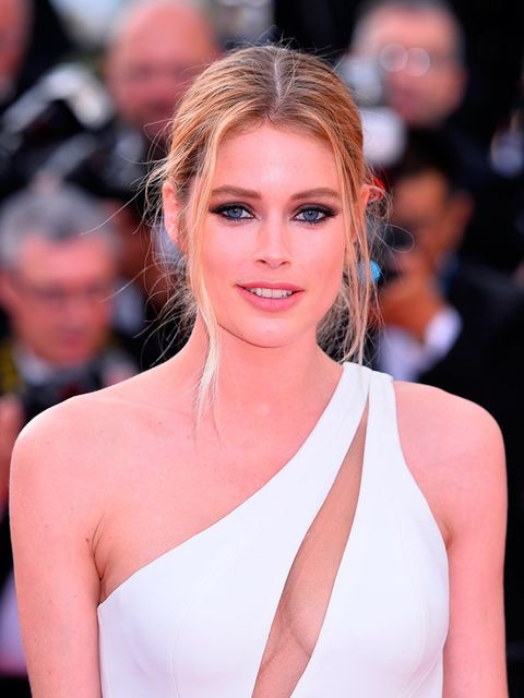 """<p><a href=""""http://www.elleuk.com/beauty/charlie-hunnam-doutzen-kroes-calvin-klein-reveal-men-fragrance-advert"""">Doutzen Kroes</a> is bang on trend with her 'blowdry backlash' hair and worn in smokey eye makeup.</p>"""