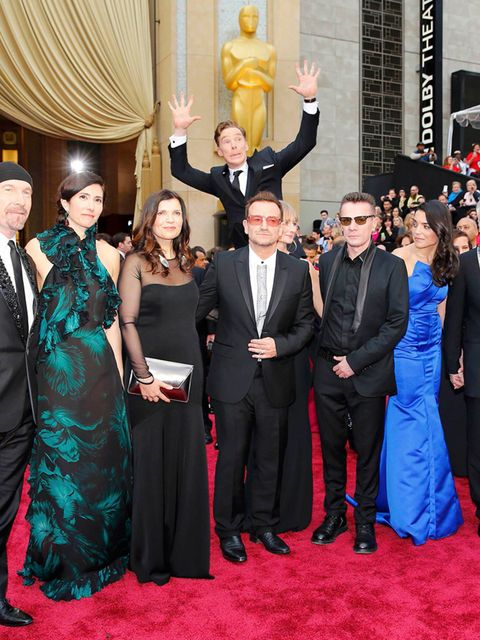<p>Benedict Cumberbatch jumps up behind U2 at the 86th Academy Awards.</p>