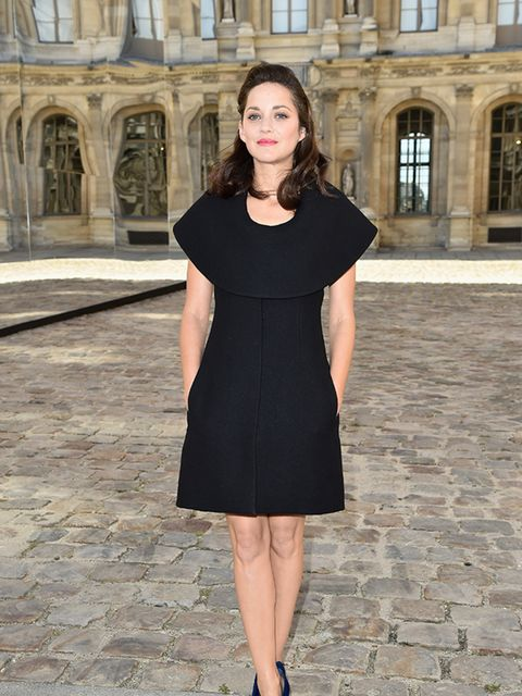 Marion Cotillard attends the Christian Dior show for Paris Fashion Week Womenswear Spring/Summer 2015 on September 26, 2014.