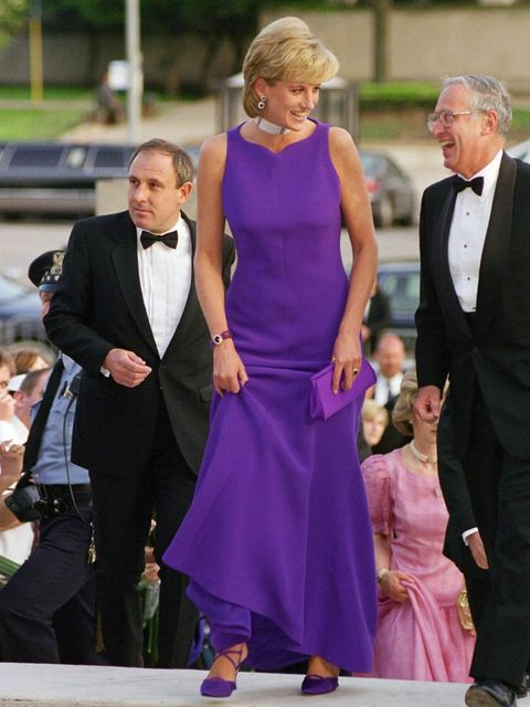 """<p>Diana, Princess of Wales arrives for a gala dinner in Chicago wearing a purple <a href=""""http://www.elleuk.com/catwalk/designer-a-z/versace/autumn-winter-2013"""">Versace</a> dress and shoes by Jimmy Choo, June 1996.</p><p><em><a href=""""http://www.elleuk.co"""
