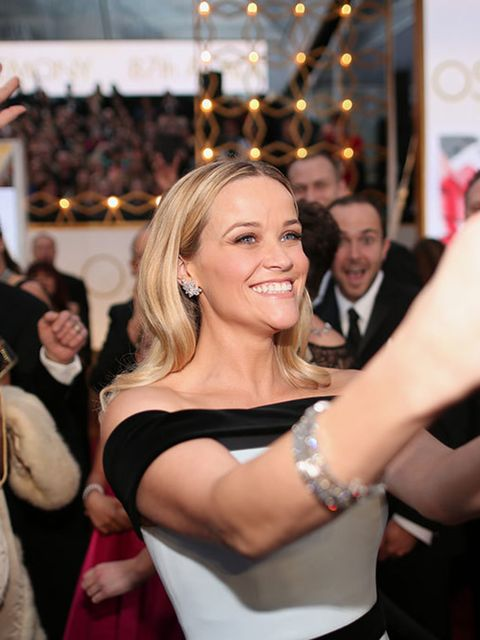 <p>Reese Witherspoon is photobombed mid-selfie.</p>