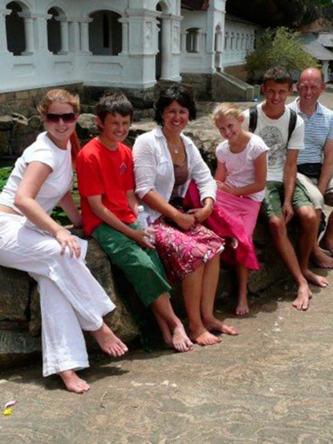 Charlotte Wallace.   Here I am with my Mum, Dad brothers and sister at a temple in Sri Lanka. We went there to see where my grandmother grew up, as her family are from there. We went to her old house, her local church,  and the disabled children's home my