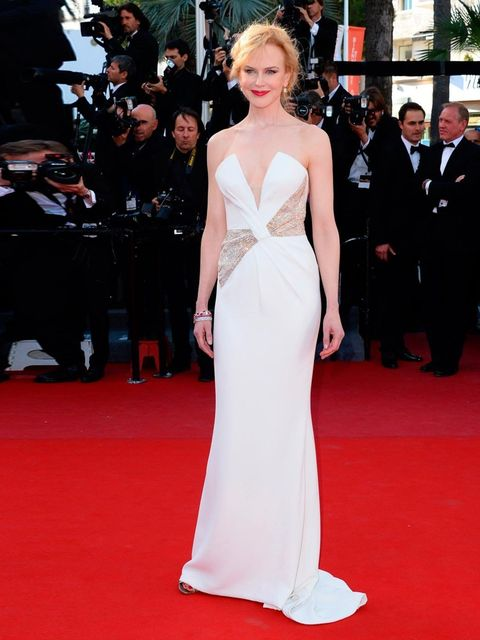 "<p>Nicole Kidman wears a custom-made <a href=""http://www.elleuk.com/catwalk/designer-a-z/giorgio-armani/"">Giorgio Armani</a> white silk gown with a gold Swarovski crystal bow bodice, styled with Harry Winston jewels, for the Closing Ceremony.</p>"