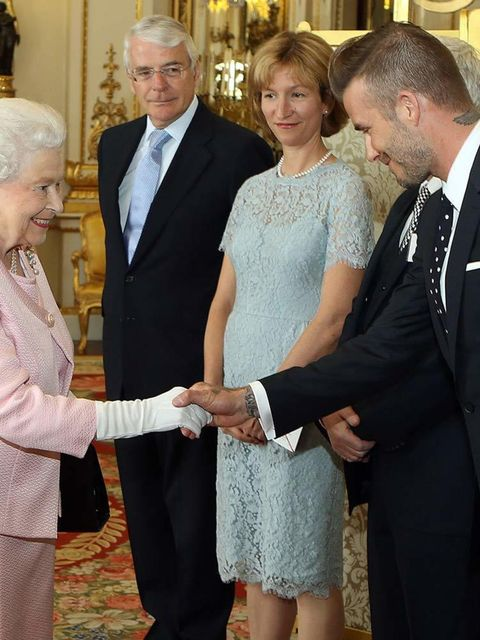 Queen Elizabeth II meets David Beckham at a reception at Buckingham Palace to celebrate The Queen's Young Leaders programme and present awards to the first successful winners of the Commonwealth project, June 2015.