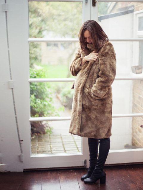 <p>Dries Van Noten coat, Margiela boots.</p>