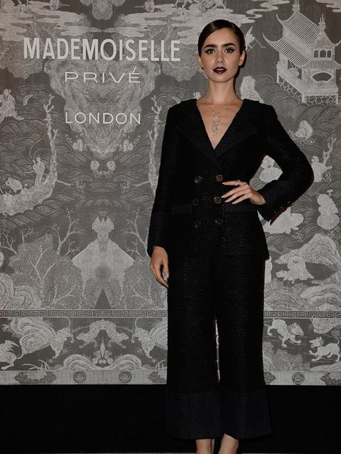 Lily Collins attends the Chanel Mademoiselle Prive exhibition at the Saatchi gallery in London, October 2015.