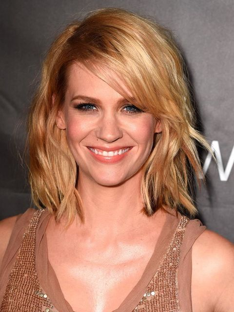 January Jones wears her long bob to her shoulders and softly tousled.