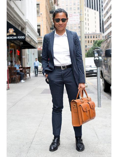 Cris Domingo wears Zara suit, Rolex watch, Ghurka bag, Brooks Brothers shoes, Rayban sunglasses and Target belt.