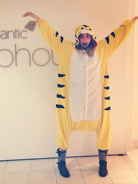 "<p><a href=""http://www.elleuk.com/star-style/celebrity-style-files/cara-delevingne-model-of-the-year-2012"">Cara Delevingne</a> in a tiger onesie.</p>"