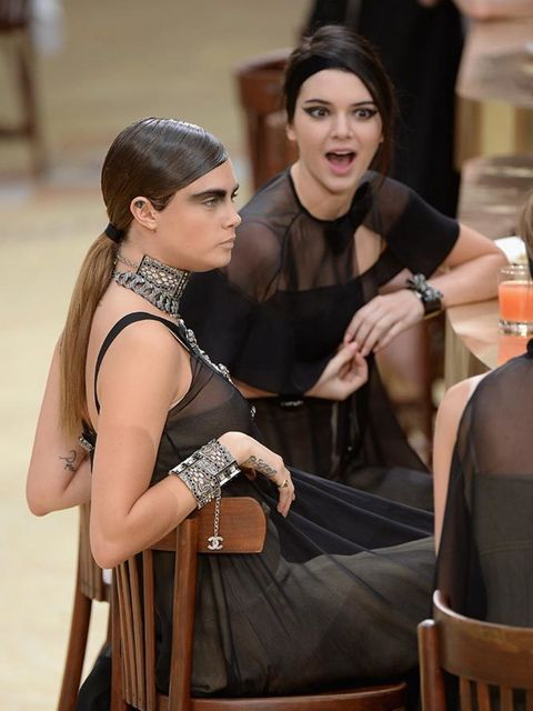 Kendall and bff Cara Delevingne during the Chanel show, March 2015.