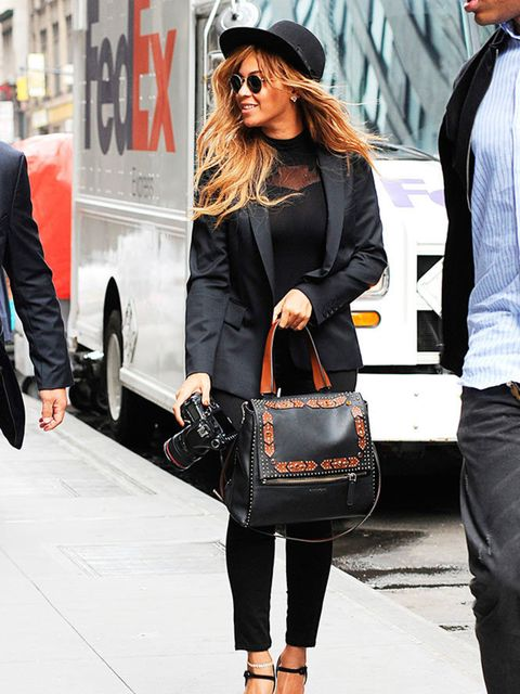 Beyonce steps out in New York wearing an all black outfit and carrying her new Givenchy bag, July 2015.