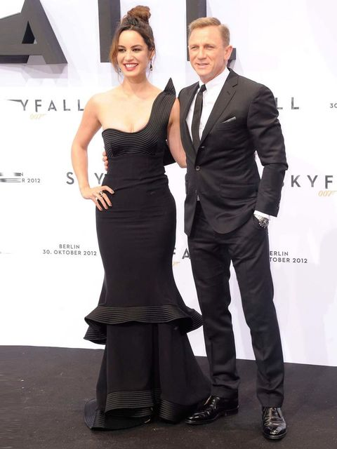 "<p>Berenice Marlohe, with Daniel Craig, in an <a href=""http://www.elleuk.com/catwalk/designer-a-z/giorgio-armani/spring-summer-2013"">Armani</a> gown, <a href=""http://www.elleuk.com/star-style/celebrity-fashion-trends/celebrities-christian-louboutin"">Chris"