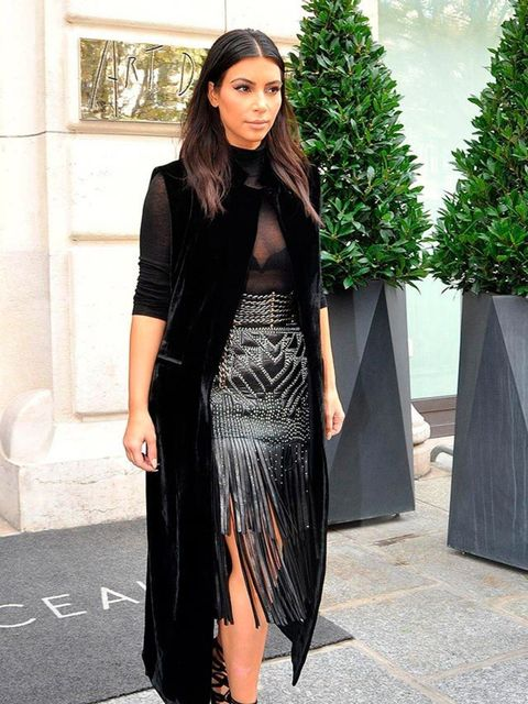<p>Kim Kardashian steps out in Roberto Cavalli during a trip to Paris, September 2014.</p>