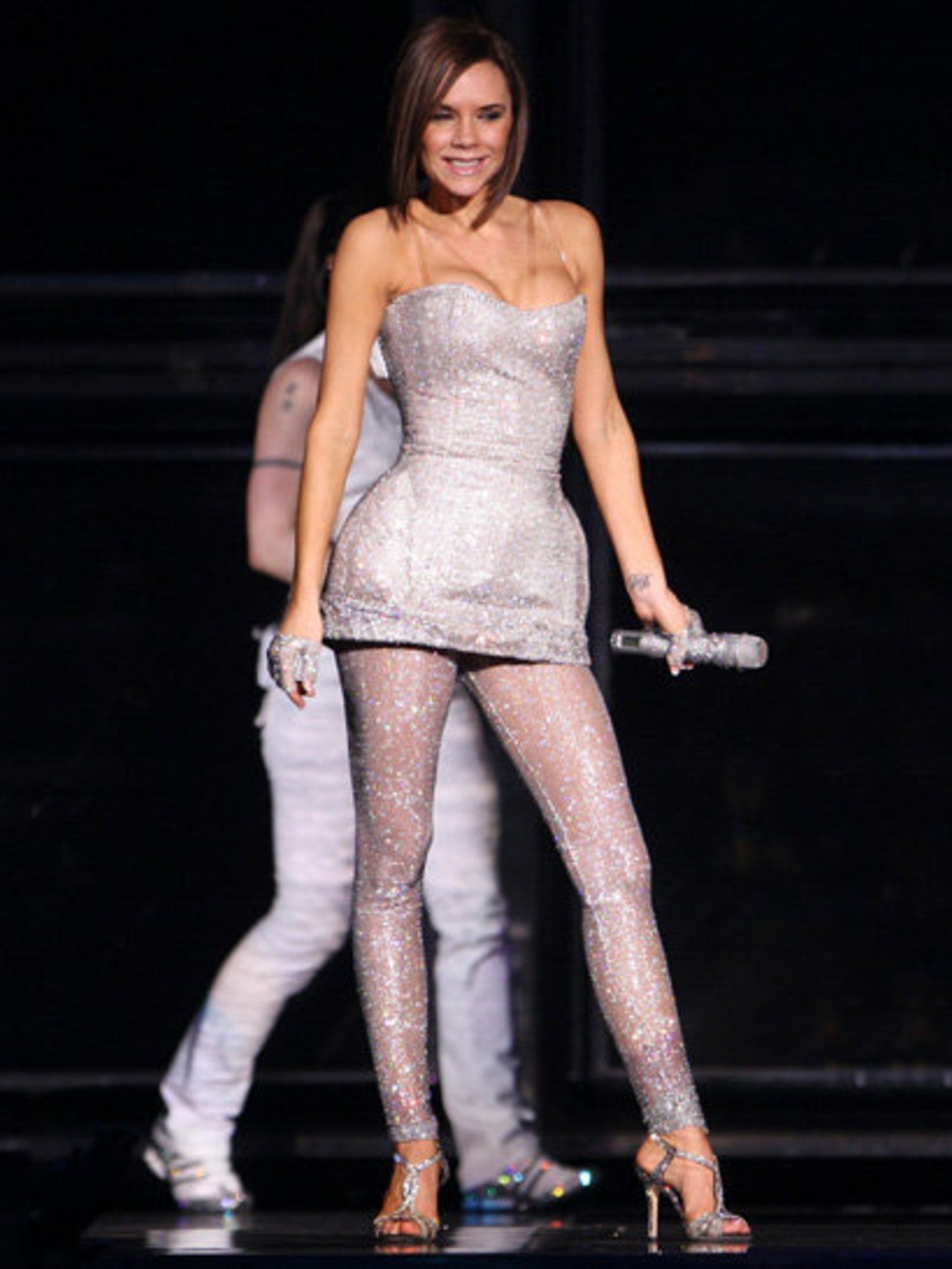 <p>Victoria Beckham onstage during the Spice Girls tour in 2008</p>