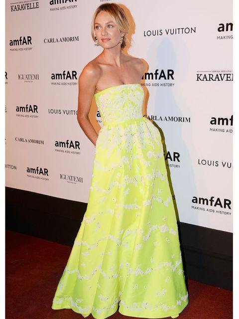 <p>Candice wears a Valentino embellished neon duchess satin dress to amfAR's Inspiration Gala Sao Paulo, Brazil.</p>