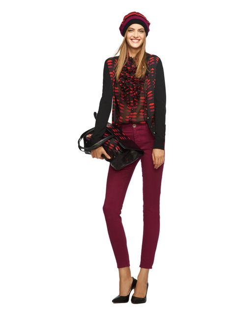 <p>Shades of red lip-print ruffle blouse, Shades of red lip-print silk-front cardigan, burgundy skinny jean, black lips tote, lipstick red striped beret.</p>