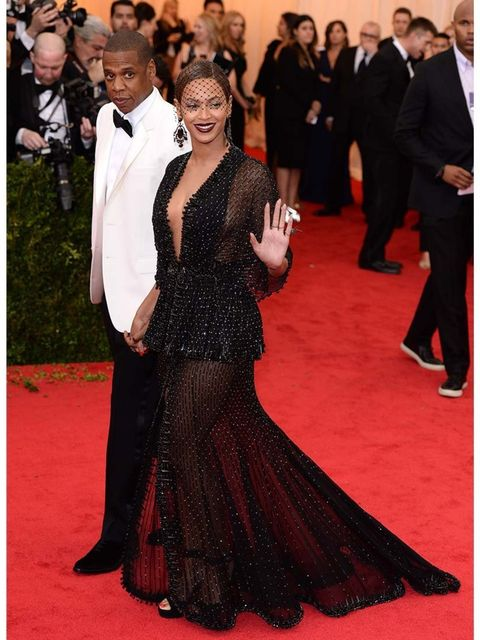"""<p><a href=""""http://www.elleuk.com/star-style/celebrity-style-files/beyonce"""">Beyoncé</a> </p><p>Black could be incredibly solid and very dark for a summer ball but because this dress sheer it has a delicacy to it. It's a great silhouette against the red ca"""