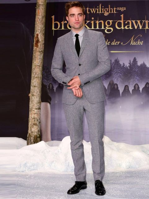 "<p><a href=""http://www.elleuk.com/star-style/celebrity-style-files/robert-pattinson-elle-man-of-the-week"">Robert Pattinson</a> wears a grey flannel suit to the Twilight Breaking Dawn Part 2 premiere in Berlin.</p>"