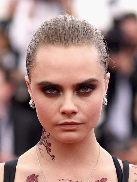 """<p><a href=""""http://www.elleuk.com/fashion/celebrity-style/cara-delevingne-s-style-file"""">Cara Delevingne</a>turned heads with cherry blossom tattoos stretching across her upper body.</p>"""