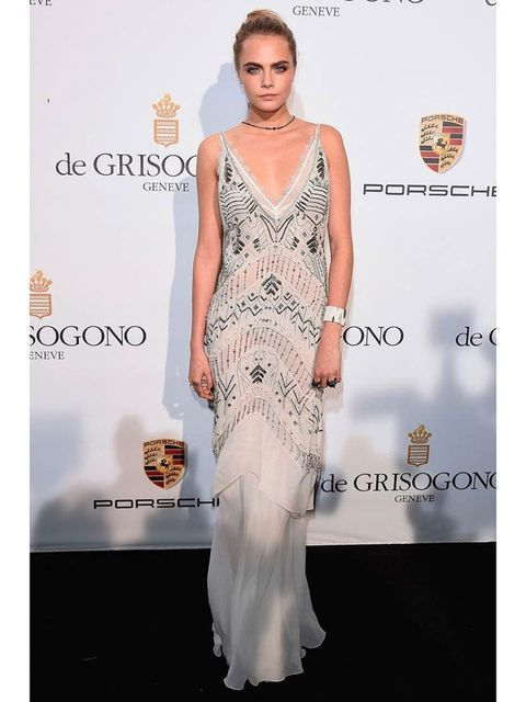 "<p><a href=""http://www.elleuk.com/star-style/celebrity-style-files/cara-delevingne-s-style-file"">Cara Delevingne</a> wears <a href=""http://www.elleuk.com/catwalk/designer-a-z/roberto-cavalli/autumn-winter-2014"">Roberto Cavalli</a> s/s 2014 to the Porsche"