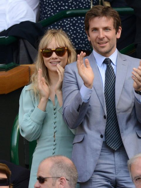 "<p><a href=""http://www.elleuk.com/elle-style-awards/news/bradley-cooper-best-actor-2013"">Bradley Cooper</a> and Suki Waterhouse at the Men's Singles Final between Novak Djokovic and Andy Murray on Day 13 of Wimbledon, London, July 2013.</p>"