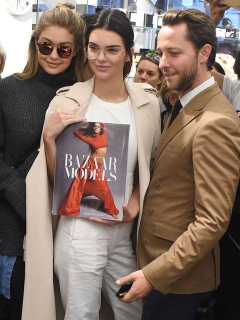Gigi Hadid, Kendall Jenner and Derek Blasberg attend an event at the Colette store, Paris.