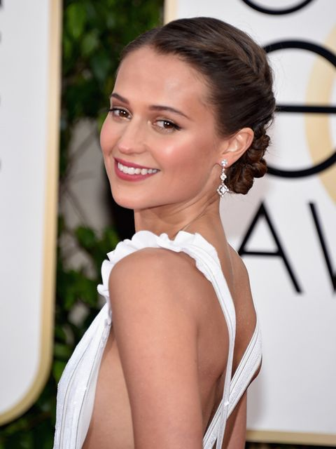<p>We love Alicia Vikander's angelic updo created by hairstylist Christopher Naselli. </p>
