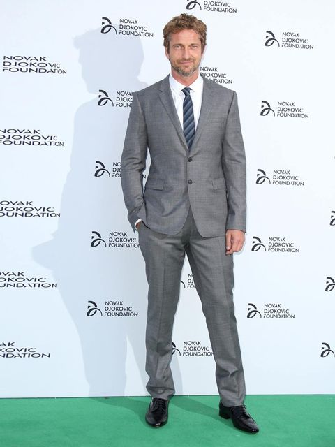 "<p><a href=""http://www.elleuk.com/star-style/red-carpet/the-cfda-awards-2011"">Gerard Butler</a> arrives for the Novak Djokovic Foundation Gala Dinner at the Roundhouse, Camden.</p>"
