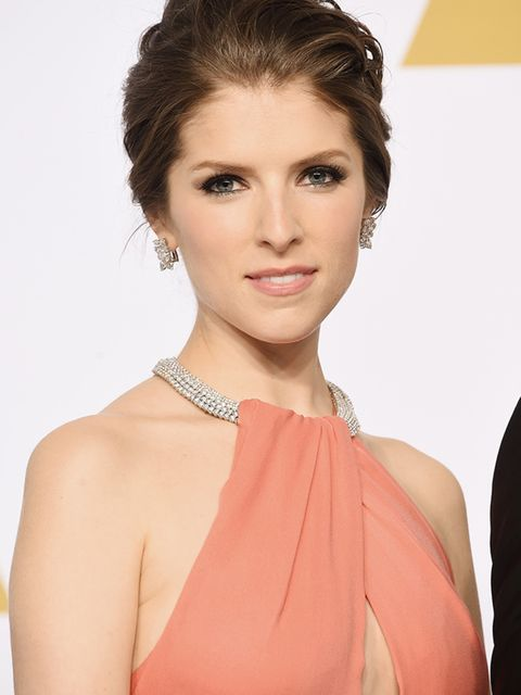 <p>Laid-back swept-back hair softens Anna Kendrick's look.</p>