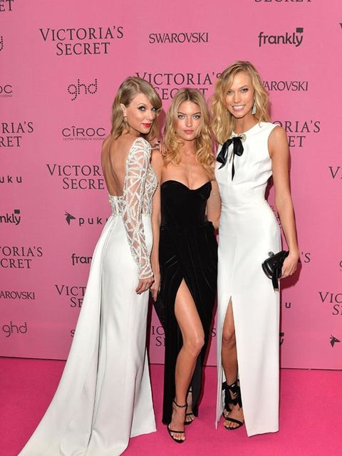 <p>Taylor Swift with Martha Hunt and Karlie Kloss wearing Alexander McQueen on the Pink carpet at the Victoria's Secret Fashion Show in London, December 2014.</p>