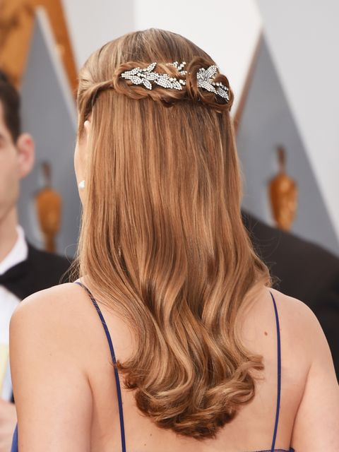 <p>The beuatiful embellishement adds something extra special to an otherwise refined half up-do for Brie Larson</p>